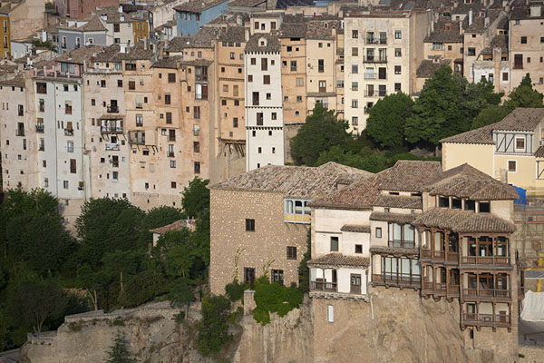 The hanging houses and skyscrapers, part of the old town, seen from the Cerro del Socorro | Cuenca old town | Spain