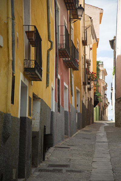 One of the narrow streets of Cuenca with colourful houses | Cuenca old town | Spain