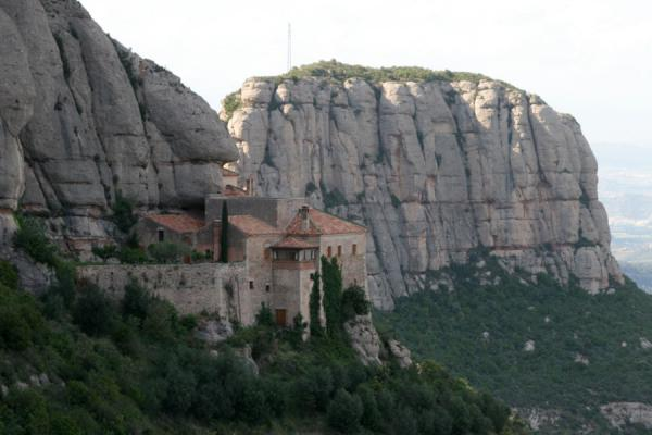 Santa Cova chapel clinging to the vertical cliffs at Montserrat | Montserrat | Spain