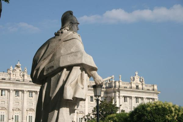 Statue on Plaza de Oriente and Royal Palace in the background | Royal Palace | Spain