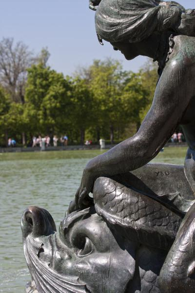 Detail of a sculpture at the Monument to Alfonso XII with the Lago de El Retiro in the background | Buen Retiro Park | Spain