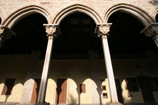Arches and shadows of arches seen from the inner courtyard of Pedralbes | Pedralbes monastery | Spain