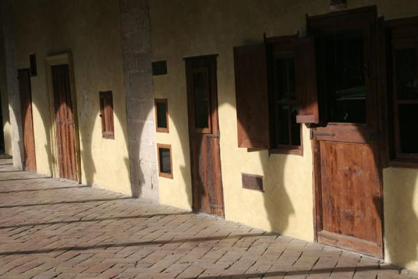 Picture of Pedralbes monastery (Spain): Sunlight on the doors of the Pedralbes monastery