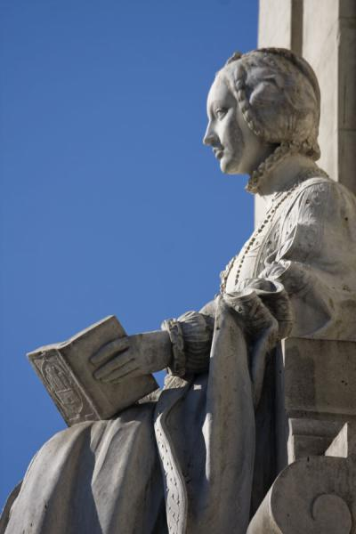 Sculpture of Isabella of Portugal with book at the Cervantes Monument | Plaza de España | Spain