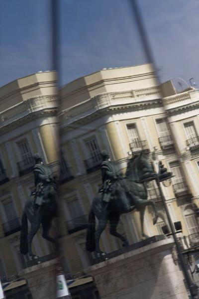 Picture of Puerta del Sol (Spain): Multiple reflection of statue of king Charles III in Sol subway station