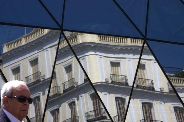 Reflection of typical building reflected in Sol subway station | Puerta del Sol | Spain