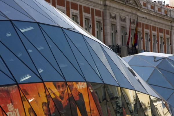 Picture of Hypermodern subway station of Sol with the Post Office in the backgroundMadrid - Spain