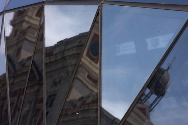 Picture of Puerta del Sol (Spain): The characteristic bell-tower of the Post Office reflected in the modern subway station of Sol