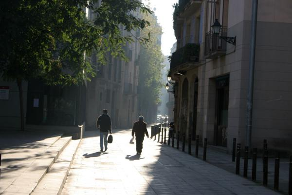 Two men walking a street in Sant Pere | Sant Pere | Spain