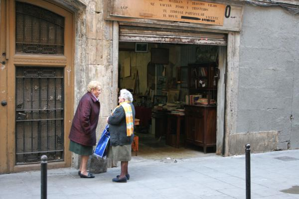 Two old women chatting in front of a store in Sant Pere | Sant Pere | Spain