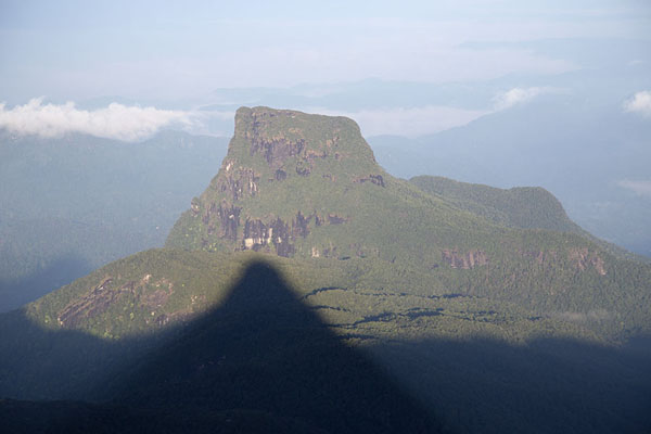 Foto van The shadow of Adam's Peak projected on a mountain to the westAdam's Peak - Sri Lanka