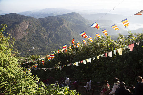 Picture of Adam's Peak (Sri Lanka): Prayer flags over the trail with the Peace pagoda in the background