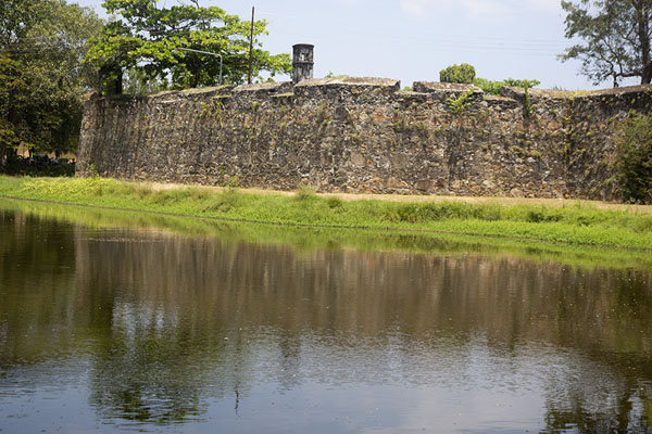 The wall of the old Dutch fort reflected in the surrounding moat | Batticaloa | Sri Lanka
