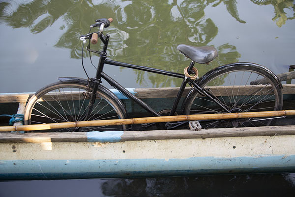 Bicycle in one of the traditional boats in the canal | Hamilton Canal | Sri Lanka