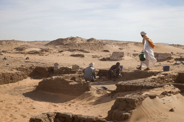 Picture of One of the Sudanese workers walking on an ancient wallAbri - Sudan