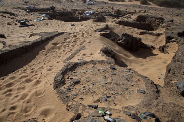 Ruins of Amara West barely visible in the desert sand | Amara West | Sudan