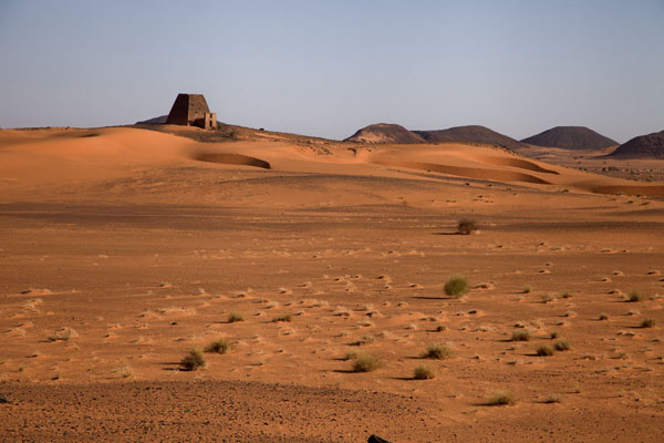 Foto di View of one of the pyramids of the northern cemetery from the southern cemetery across the desert - Sudan - Africa