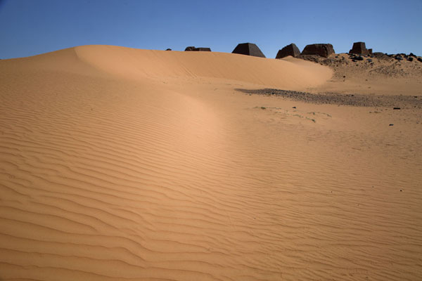Picture of Sand dune with several of the pyramids of the northern cemetery in the backgroundBegrawiya - Sudan