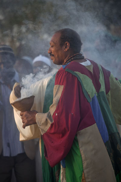 One of the dervishes spreading smoke over the followers | Hamed El Nil dervishes | Sudan
