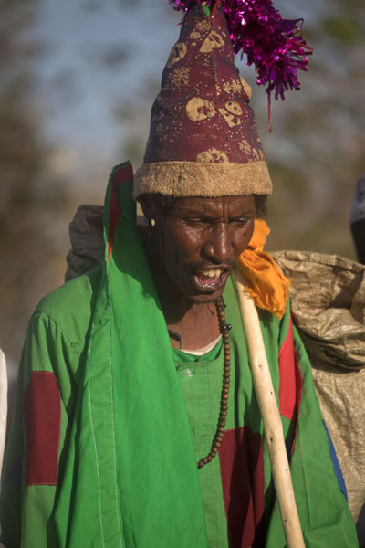 One of the dervishes dressed in green, with a pointed hat | Hamed El Nil dervishes | Sudan