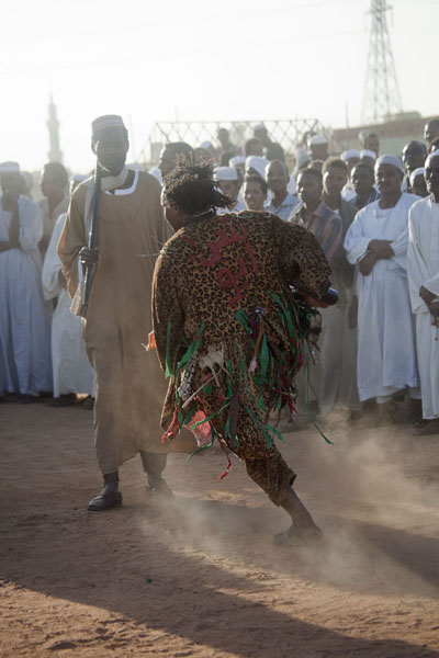 One of the dervishes moving around in a frenzy, making the sand whirl with him | Hamed El Nil dervishes | Sudan