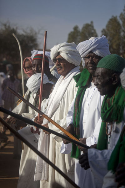Sufis participating in the ceremony with their curved sticks | Hamed El Nil dervishes | Sudan