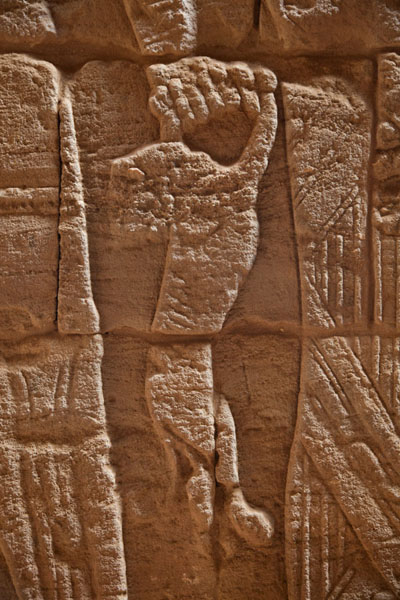 Lion cub being held by a god inside the Lion Temple | Musawarat es Sufra | Sudan