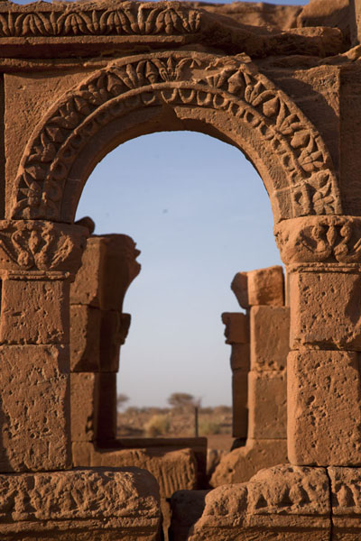 Looking through a richly decorated window pane of the Kiosk | Naqa | Sudan