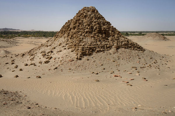 Crumbling pyramid rising from the sand of the desert | Nuri pyramids | Sudan