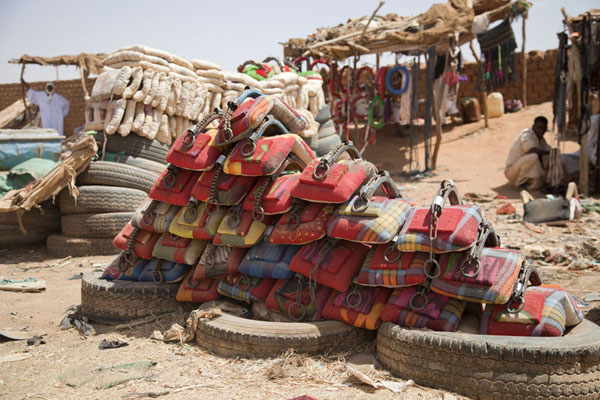Picture of Omdurman Camel Market (Sudan): Colourful saddles for sale at the animal market of Omdurman