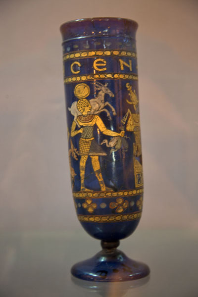 Picture of Vase with golden gods and a Greek inscription on a blue background on display in the museum