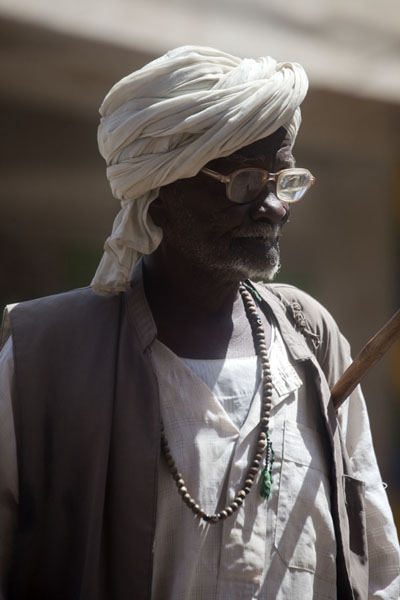 Old man with glasses and white turban in the streets of Kassala | Sudanese people | Sudan
