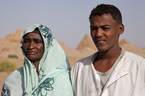 Son and mother at the Nuri pyramids | Sudanese people | Sudan