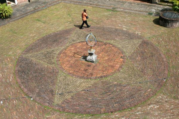 Person walking on the small square inside Fort Zeelandia | Fort Zeelandia | Surinam