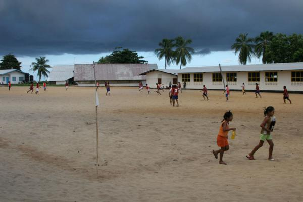 Football field in Galibi with dark grey sky | Galibi | Surinam