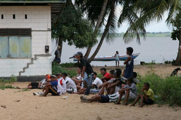 Sitting on the beach while watching a football match | Galibi | Surinam