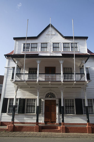 Picture of Paramaribo Architecture (Surinam): Morning sun shining on a traditional white wooden building in Paramaribo