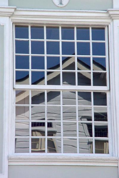 Picture of Wooden house in window, Paramaribo