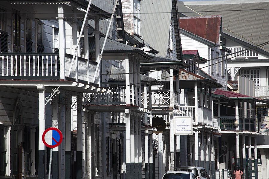 Row of traditional whitewashed buildings on the Heerenstraat in Paramaribo | Paramaribo Architecture | Suriname