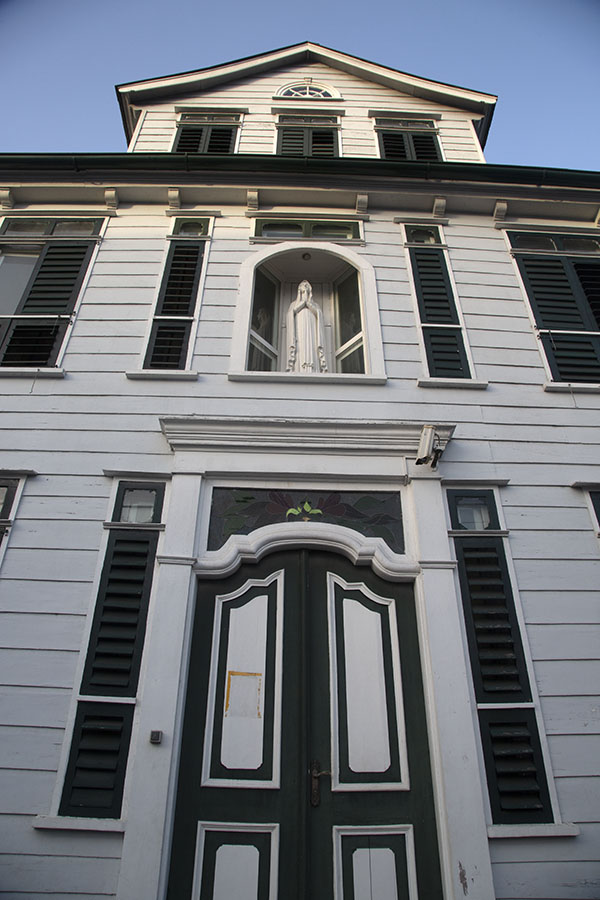 Looking up a building with a statue of Virgin Mary | Paramaribo Architecture | Suriname