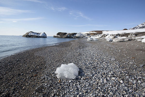Pebble beach with chunk of ice near Camp Millar | Camp Millar |