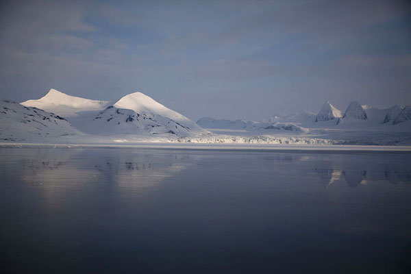 Picture of Snow-capped mountains and glacier reflected in the quiet waters of Hornsund - Svalbard and Jan Mayen - Europe