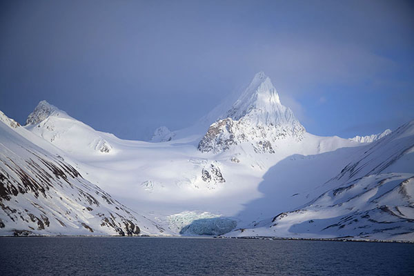 Hornsundtind mountain with small glacier in the foreground | Hornsund | Svalbard and Jan Mayen