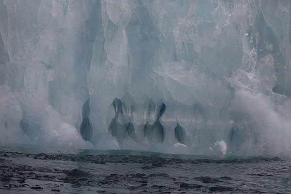 Foto van Close-up of holes in an iceberg in HornsundHornsund -