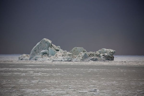 Picture of Iceberg under a dark sky in MohnbuktaMohnbukta - Svalbard and Jan Mayen