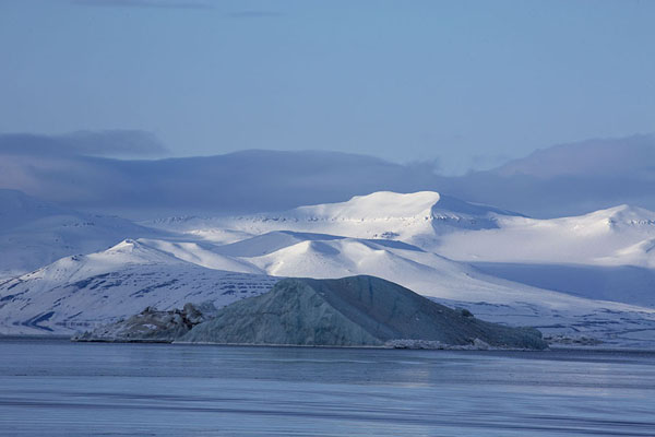 Picture of Iceberg and snow-covered mountains near MohnbuktaMohnbukta - Svalbard and Jan Mayen