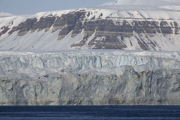 Picture of Mountain range visible above the massive glacier of NegribreenNegribreen - Svalbard and Jan Mayen
