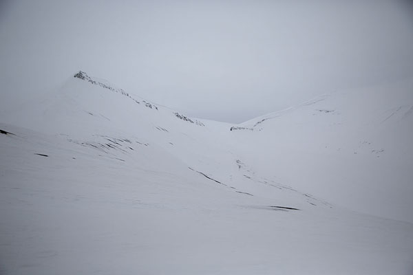 The contours of Trollsteinen in snow | Sarkofagen and ice cave hike | Svalbard and Jan Mayen