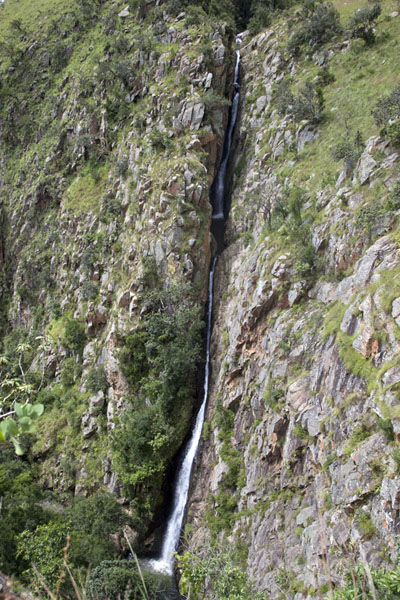 Thin and tall Majolomba Falls cutting through the rocks | Malolotja National Park | Swaziland