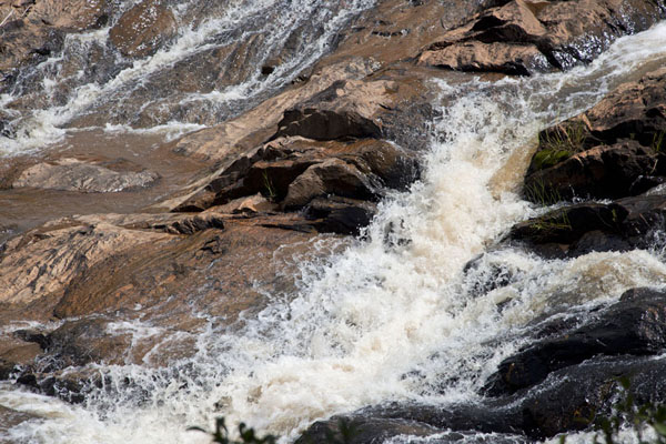 Side view of the water rushing down the rocks at Phophonyane | Chute du Phophonyane | Swaziland